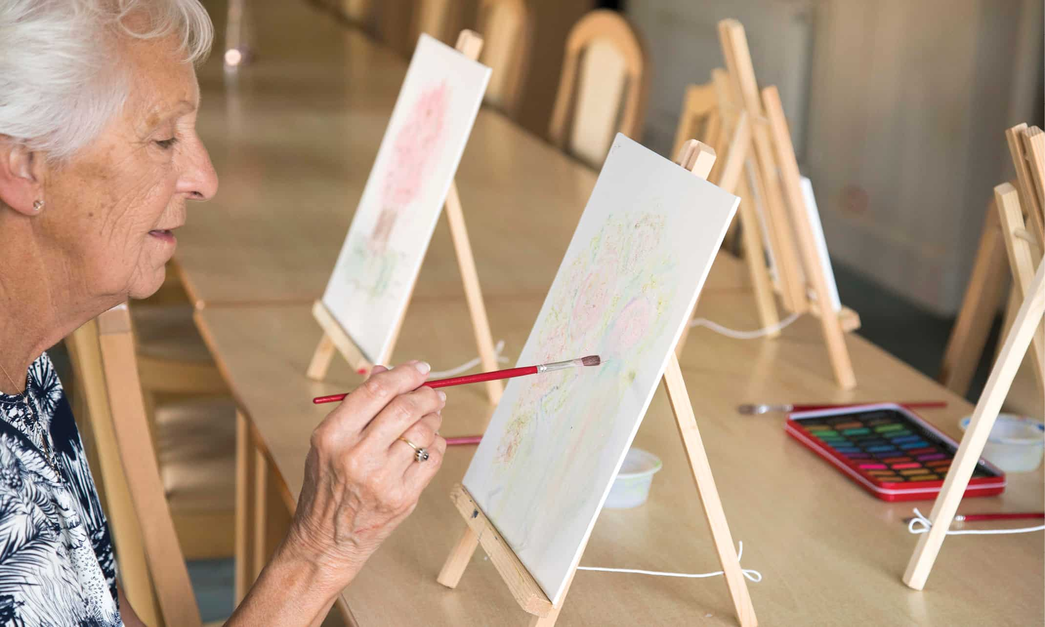 Wellbeing - Lady painting at St Vincent's